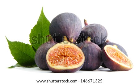 Ripe sweet figs with leaves isolated on white - stock photo