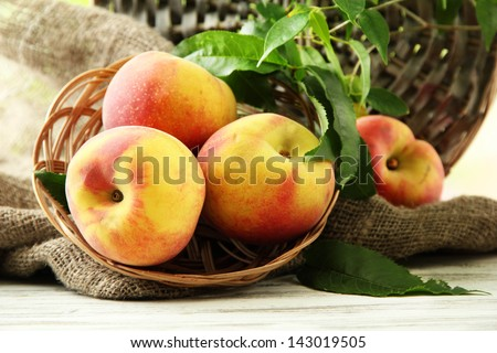 Ripe sweet peaches on wooden table, close up - stock photo