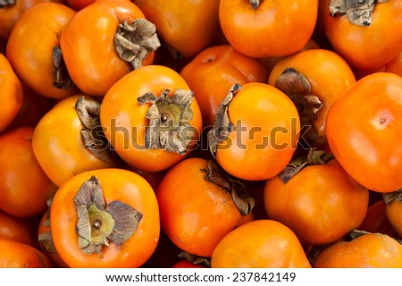 Ripe sweet persimmons - stock photo
