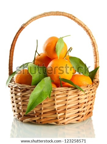 Ripe sweet tangerine with leaves in basket, isolated on white - stock photo