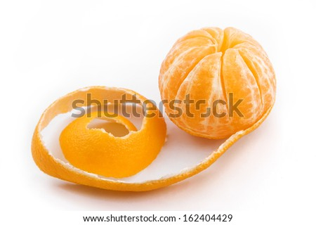 Ripe sweet tangerine with peeled spiral skin