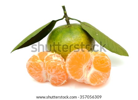 ripe tangerine fruits with leaves isolated on white background - stock photo