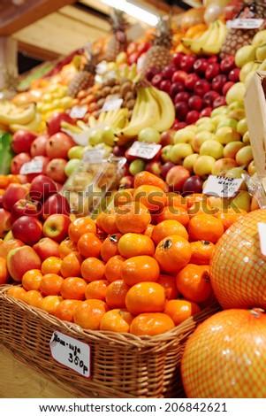 Ripe tangerines on market stall, close-up - stock photo