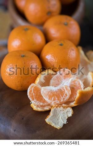 Ripe tangerines on wooden background - stock photo