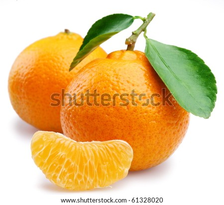 Ripe tangerines with leaves and slices on white background - stock photo