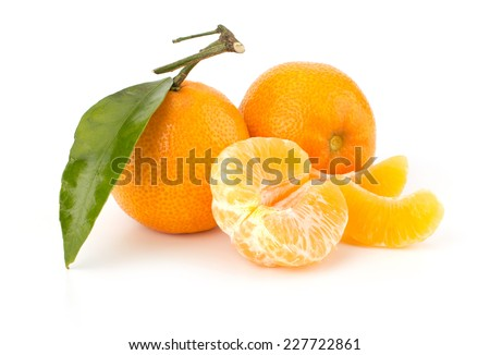 Ripe tangerines with leaves isolated on white background - stock photo