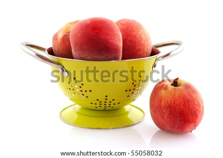 Ripe tasteful and soft nectarines washing in colander