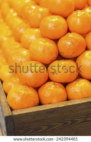 Ripe tasty tangerines in wooden box, Close-up. - stock photo