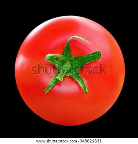 Ripe tomato closeup isolated on black background - stock photo