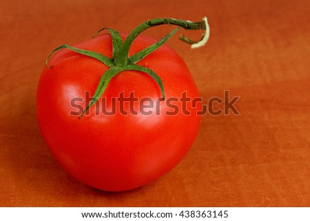 Ripe tomato on a wooden table, fruits, vegetables, red - stock photo