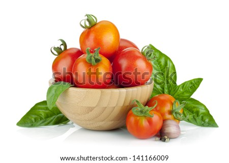 Ripe tomatoes, basil, garlic. Isolated on white background - stock photo