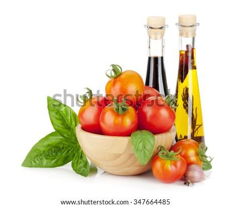 Ripe tomatoes, basil, olive oil, vinegar. Isolated on white background - stock photo