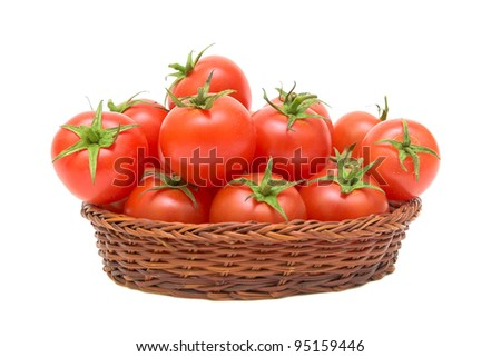 ripe tomatoes in a wicker basket isolated on white background - stock photo