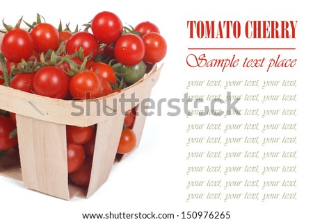 Ripe tomatoes in a wooden box isolated on white background