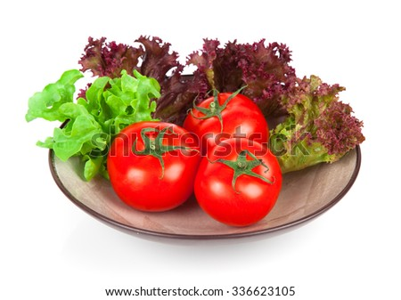 Ripe tomatoes in bowl and basil. Isolated on white background - stock photo