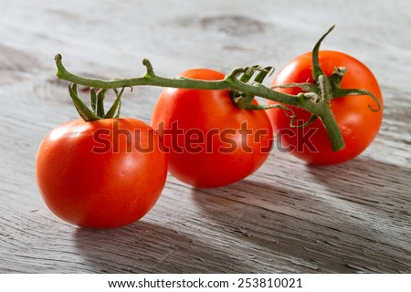 Ripe Tomatoes on a Grungy Old Outdoors Table