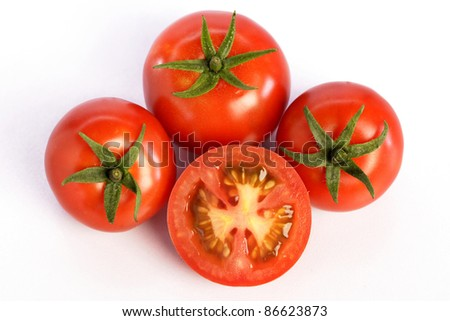 Ripe tomatoes on white - stock photo