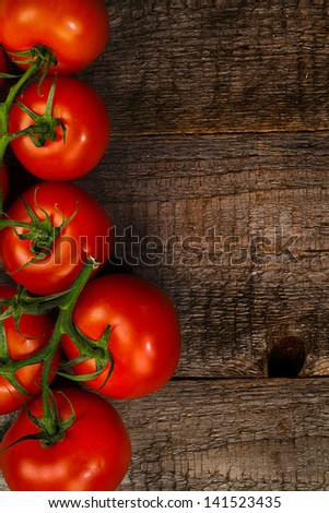 ripe tomatoes on wooden table