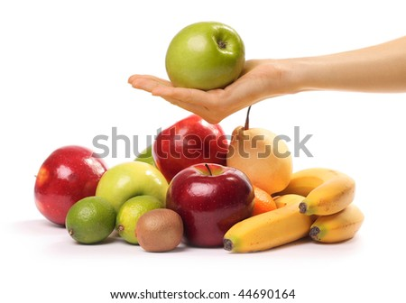 Ripe tropical fruits and hand - stock photo