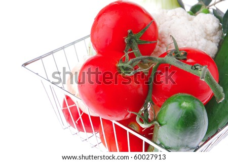 ripe vegetables in metal store basket on white - stock photo