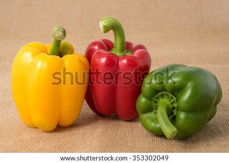 Ripe vibrant colorful peppers on sackcloth - stock photo