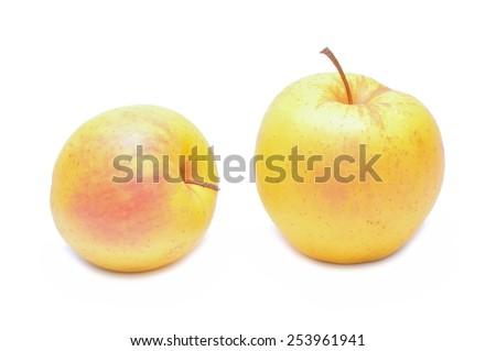 Ripe yellow apple isolated on white background - stock photo