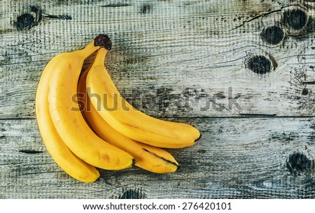 Ripe yellow bananas on old wooden boards - stock photo