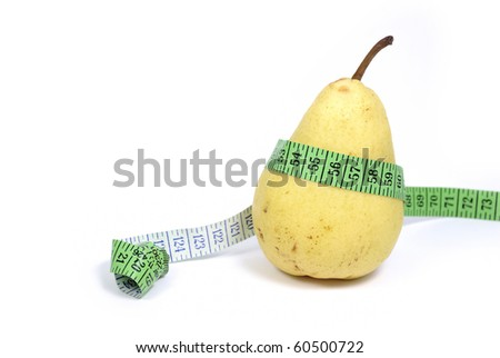 Ripe yellow pear with measuring tape - stock photo