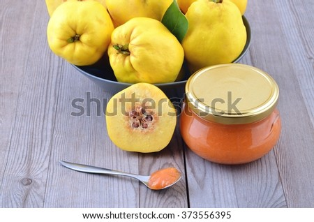 Ripe yellow quinces and quince marmalade. - stock photo