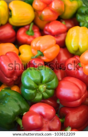 Ripe Yellow, Red, Orange and Green Peppers in Vegetables Market - stock photo