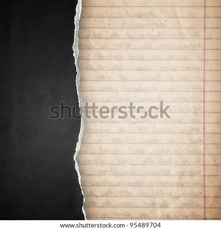 riped black cardboard cover on guideline paper background - stock photo