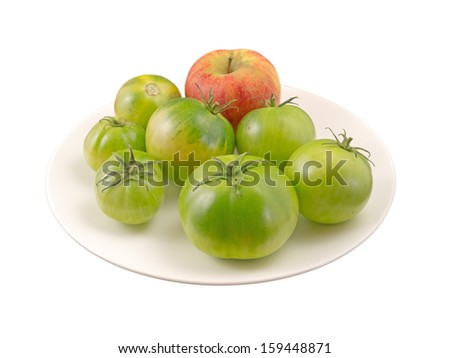 Ripening tomatoes and an apple. - stock photo