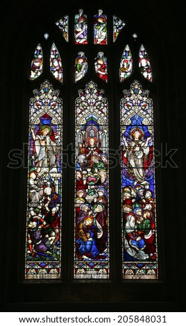RIPON, NORTH YORKSHIRE - JULY 17, 2014: Stained glass window. Ripon Cathedral is a seat of the Bishop of Leeds and is situated in the small North Yorkshire city of Ripon.
