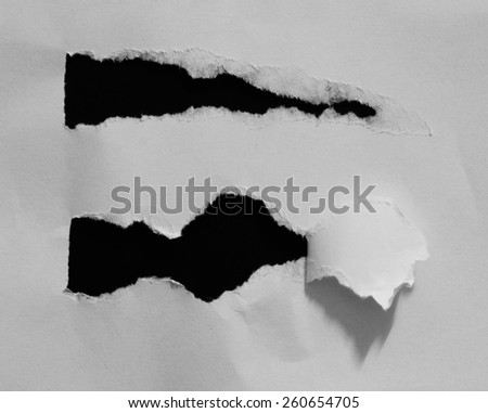 Ripped black and white paper, copy space - stock photo