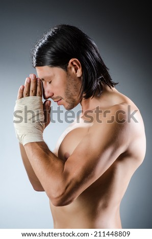 Ripped martial arts expert at training - stock photo