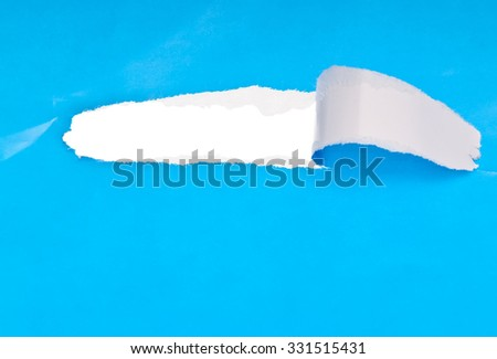 ripped open paper colored blue - stock photo