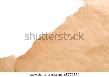 Ripped packaging or gift paper.  Plenty of copy space. - stock photo