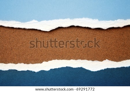 Ripped paper on brown background - stock photo