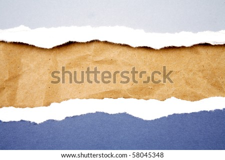 Ripped  paper on brown paper - stock photo