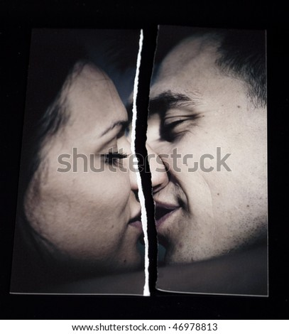 Ripped photograph concept.  Broken love relationship - stock photo