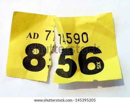 Ripped raffle ticket - stock photo