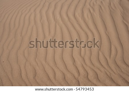 Ripple and line textures of sand.
