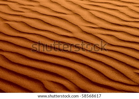 Rippled Golden Brown Beach Sand Texture Background - stock photo