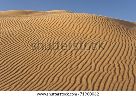 Rippled sand dune on late afternoon (Imperial Dunes, California) - stock photo