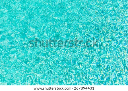rippled surface of pool or tropical sea vibrant water - stock photo