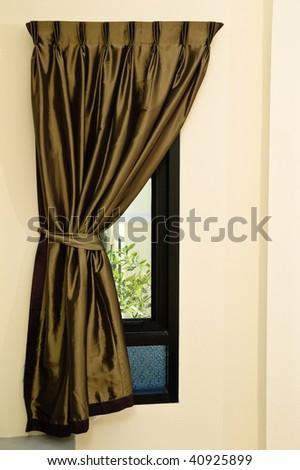 rippled textile curtain on a window - stock photo
