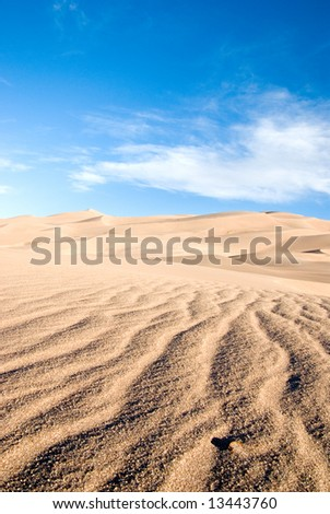 ripples in the sand in front of sand dunesw - stock photo