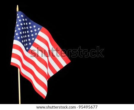 Ripples in US Flag isolated on black background with room for your text - stock photo