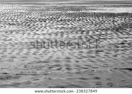 ripples of sand on the beach in Beal county Kerry Ireland in black and white - stock photo
