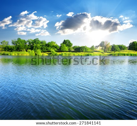 Ripples on the river at sunny summer day - stock photo